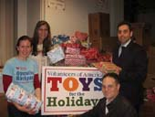 Africa Israel USA lends their support (and space at Manhattan's Clock Tower Building) to Volunteers of America's 2011 Christmas Toy Drive (from left: Kristin Kelly-Jangraw of Volunteers of America and Laurie Golub, Damien Stein and Ilya Braz of