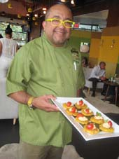 07-15-15 Executive Chef Frank Maldonado serves hors d'oeuvres. plantain with hummus and tomato at a food tasting at Sofrito. Riverbank State Park. Riverside Drive at 144th St. Tuesday night. 07-14-15.  Photo by:  Aubrey Reuben