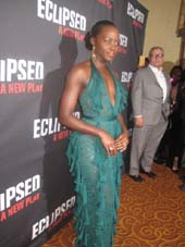 "03-07-16 Cast member Lupita Nyong'o and Rick Miramontez watches at the opening night party of ""Eclipsed"" at the Gotham Hall. 21356 Broadway. .   Photo by:  Aubrey Reuben"