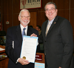 Miles Coon receives a proclamation from Mayor Woodie McDuffie declaring that January 18-23, the dates of the 6th annual Palm Beach Poetry Festival, is officially Delray Beach Poetry Week