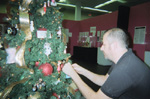Macy�s Visual Manager Michael Steele decorates Barbie Christmas Tree at the Museum of Lifestyle & Fashion History