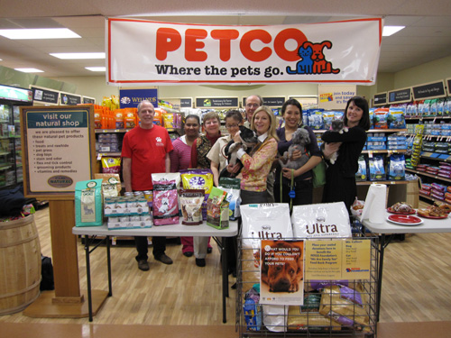 Steve Gruber, Director of Communications for the Mayor's Alliance for NYC's Animals; Tysha McGill, donating PETCO customer; Jane Hoffman, President of the Mayor's Alliance for NYC's Animals; Arisa Srivilai-Sutunya, PETCO employee; Steve Crall, General Manager of PETCO store; Susan Kaufman, founder of the Animal Relief Fund; Caroline Mayer, foster parent of Peter, a Picasso Veterinary Fund dog available for adoption (pictured); and Amy Bennett, Director of Communications for Anjellicle Cats Rescue