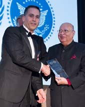 Lord Raj Loomba, Founder and Chairman Trustee, The Loomba Foundation receiving award from Abid Qureshi, UNA-NY President