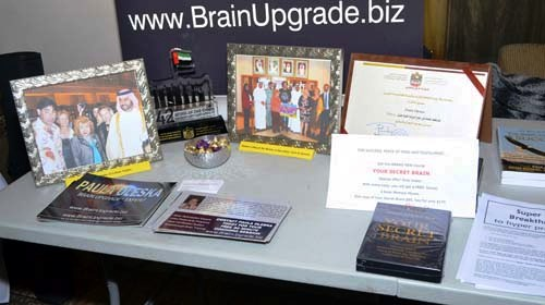 Brain Upgrade sponsorship table, with pictures of our group picture from our trips to Dubai