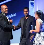Denzel Washington (center) and BGCA National Youth of the Year Whitney Stewart (right) presented the Champion of Youth Award to Evander Holyfield (left)