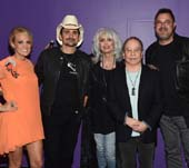 Carrie Underwood, Brad Paisley, Emmylou Harris, Paul Simon, and Vince Gill. Photo by Rick Diamond, Getty Images for the Country Music Hall of Fame and Museum