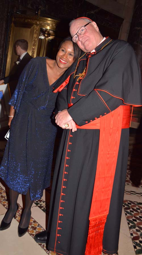 Master of Ceremonies, Magalie Laguerre-Wilkinson, 60 Minutes-CBS and  His Eminenece Timothy Cardinal Dolan.  Photo by:  Rose Billings/Blacktiemaagzine.com