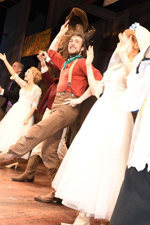 Actor Conor Ryan kicks up his heels and tosses his hat in a crowd-pleasing rip-roaring hysterical performance as the Johnny Blood cowboy character.  Photo by:  Rose Billings/Blacktiemagazine.com