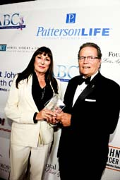 Patrick Wayne (right) presented the Spirit of Hollywood Award to Anjelica Huston (left)
